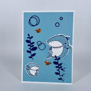 Karte mit großem und kleinem Hai